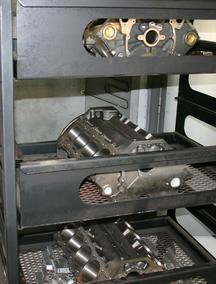 V8 cast iron engine blocks inside oven