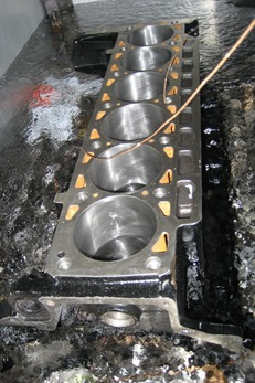 BMW 6 cylinder engine block being cryogenically treated, soaking in liquid nitrogen -320° F (-196° C)