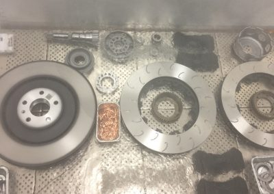 Assortment of high performance automotive brake rotors, pads, & miscellaneous.